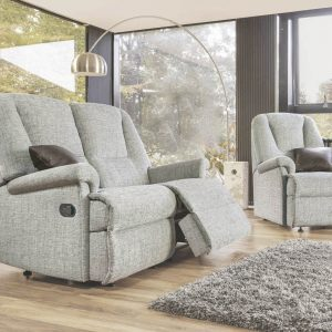 Reclining chair and settee situated in a garden room